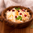 Wooden bowl of sauerkraut — Stock Photo #39113365