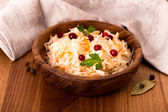 Wooden bowl of sauerkraut — Stock Photo