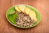 Sliced ginger and  green coffee beans — Stock Photo