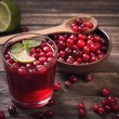 Stock Photo: Cranberry juice on old wooden table