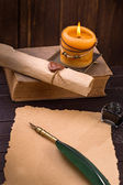 Old paper candle and quill pen — Stok fotoğraf
