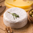 Brie cheese with olives — Stock Photo