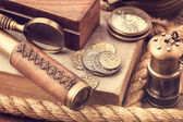 Old coins and nautical accessories — Stock Photo
