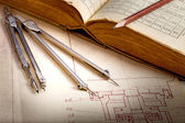Old engineering drawing and book — Stock Photo