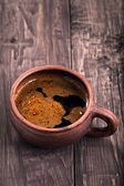Mug of coffee on a wooden table  — Stock Photo