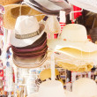 Market stand with hats — Stock Photo