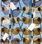 Market stand with sunglasses — Stock Photo
