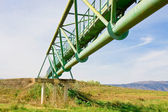 Metal bridge across a valley (from below) — Stok fotoğraf