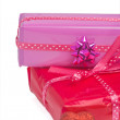 Pair of gifts and a heart - Stock Photo