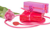 Gifts with a rose isolated — Stock Photo
