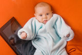 Funny baby with tablet — Stock Photo