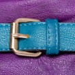 Blue faux leather strap on violet — Stock Photo