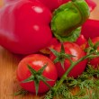 Extreme closeup on branch of cherry tomatoes — Stock Photo