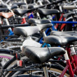 Bike detail at packed bicycle parking — Stock Photo