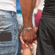 Male couple holding hands — Stock Photo