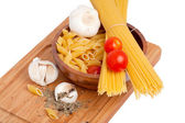 Basil and cherry tomato pasta — Stock Photo