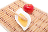 Red apple and honey — Stock Photo
