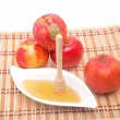 Honey dipper with pomegranate — Stock Photo