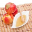 Stock Photo: Pyramid of red apples and honey in gravy boat