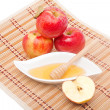 Stock Photo: Sliced apple and honey dipper