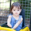 Little girl plays a driver — Stock Photo
