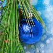 Stock Photo: Blue necklace and ball on Christmas tree