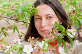 Closeup portrait in spring blossom — Stock Photo