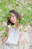 Female portrait in spring blossom — Stock Photo