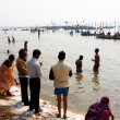 asian bathing in holy sangam during the festival kumbh mela — Stock Photo