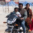 Family rides a motorbike on a holiday in Asia - Foto Stock