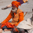 Holy hindu man Sadhu prays on the ground  — Stock Photo