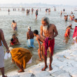 Stock Photo: Senior mcomes out from water of sacred Sangam