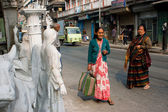 Senior women wait for the transport at sculpture masters street — Stock Photo