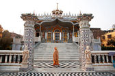Asian woman goes in front of Jain Temple — Stock Photo