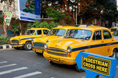 Yellow taxi cabs stopped at a pedestrian crossing — Stock Photo