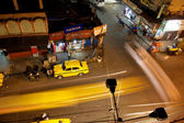 Night city with fast moving Ambassador taxi cabs — Stock Photo