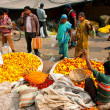 Постер, плакат: Asian women and man choose the flowers on crowded Flower Market