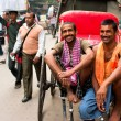 Two workers of hand-pulled rickshaw smile — Photo