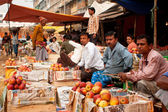 Fruit market sellers wait for the customers outdoor — Stock Photo