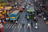 Many private cars, yellow cabs and public buses on the street traffic jam — Stock Photo