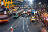 And cars blurred in motion on the busy street — Stock Photo
