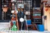 Second hand store and used items on the flea market — Stock Photo