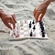Image of human hands with chess figure making move — Stock Photo