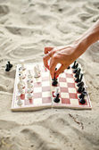 Image of human hand with chess figure making move — Fotografia Stock