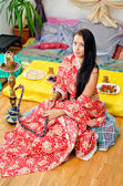 Young Indian girl in traditional red clothing with Hookah — Stock Photo