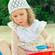 Little girl playing with toys on the beach — Stock Photo #12176798