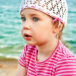 Portrait of cute little girl on the beach — Stock Photo #12176803