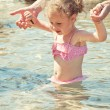 Stock Photo: Cute little girl having fun in the sea