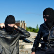 Stock Photo: Two criminals getting ready for robbery