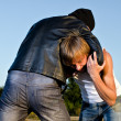 Stock Photo: Two men fight outdoors. Robbery concept